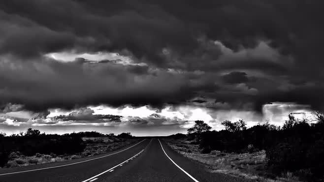 Dark Clouds on a Dark Road